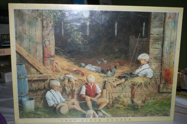 Image of the puzzle 2000, JR Puzzles, Heads Down, by Spencer Coleman, Factory Sealed, Listed by Cathy