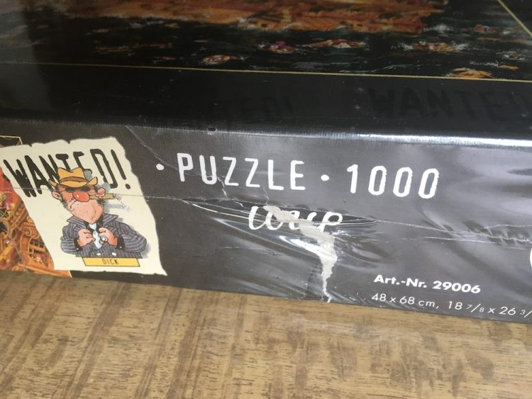 Image of the puzzle 1000, Heye, Wanted! Where is Diamond Dick?, Jean-Jacques Loup, Factory Sealed, Picture of the side