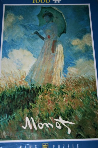 Image of the puzzle 1000, King, Woman with Umbrella, Claude Monet, Factory Sealed, Listed by Cathy