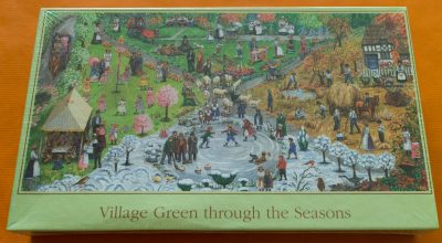 Image of the puzzle 1000, Express Gifts, Village Green through the Seasons, by Gale Pitt, Factory Sealed, Picture of the box