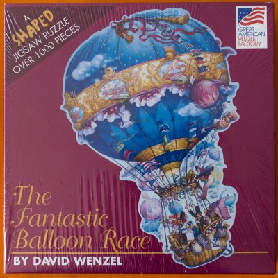 Image of the puzzle 1000, Great American Puzzle Factory, The Fantastic Balloon Race, by David Wenzel, Picture of the box