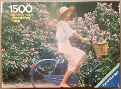 Image of the puzzle 1500, Ravensburger, Girl on a Bicycle, by David Hamilton, Complete, Picture of the box