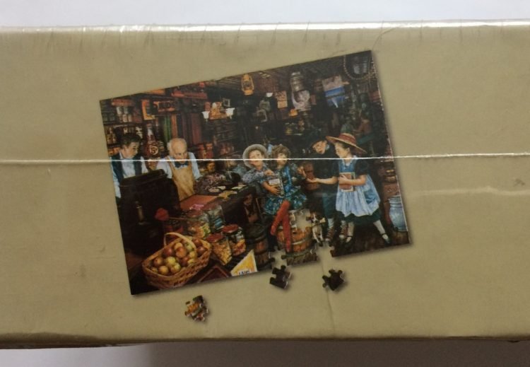 Image of the puzzle 1500, WHSmith, Lucky Marbles, by Susan Brabeau, Factory Sealed, Detail of the box