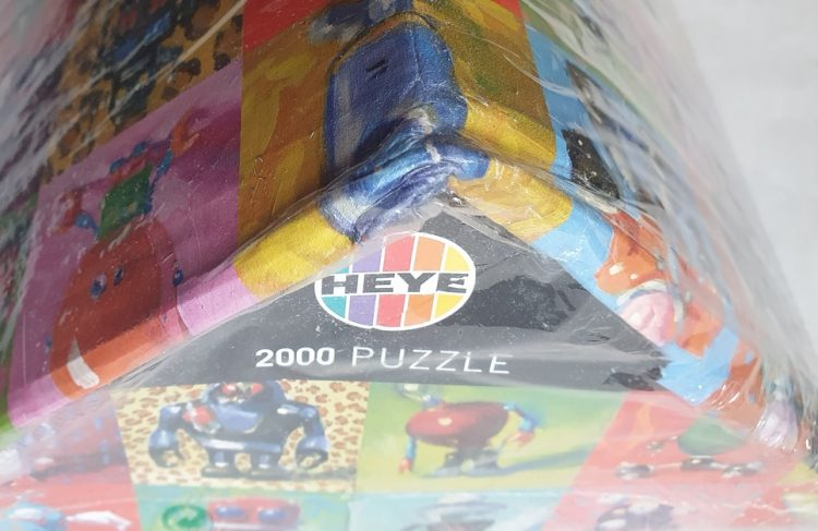 Image of the puzzle 2000, Heye, Robots, by Henry Stinson, Factory Sealed, Detail of the box