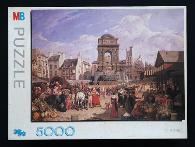 Image of the puzzle 5000, MB, The Market and Fountain of the Innocents, Paris. Picture of the box.