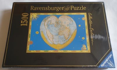 Image of the puzzle 1500, Ravensburger, Heart-Shaped Antique World Map. Picture of the box.