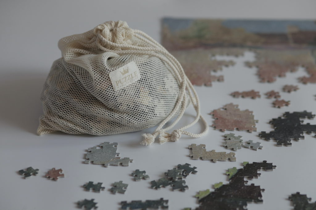 Image of a puzzle bag with pieces